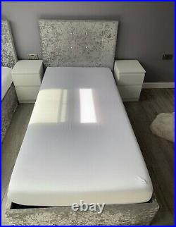 Two single grey velvet beds with storage